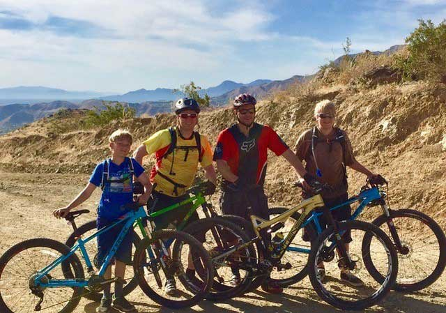 Dr. Hawkins with others mountain biking.